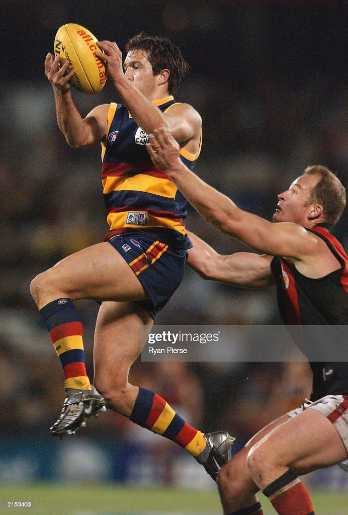 Chris Ladhams for the Crows imarks in front of Sean Wellman for the Bombers during the round 15 AFL match between the Adelaide Crows and the Essendon...