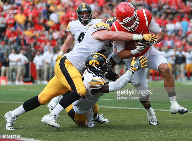 Chris Laviano of the Rutgers Scarlet Knights is tackled by Josey Jewell and Desmond King of the Iowa Hawkeyes at High Point Solutions Stadium on...