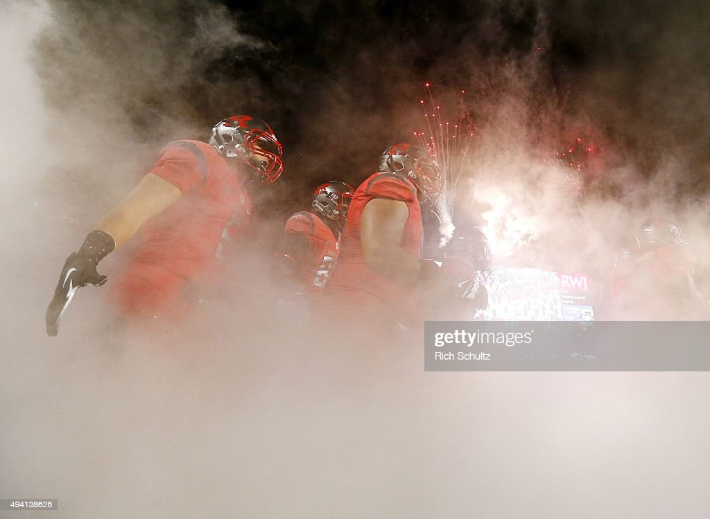 Chris Laviano #5 of the Rutgers Scarlet Knights runs with his team onto the field before a game against the Ohio State Buckeyes at High Point Solutions Stadium on October 24, 2015 in Piscataway, New Jersey. Ohio State defeated Rutgers 49-7.