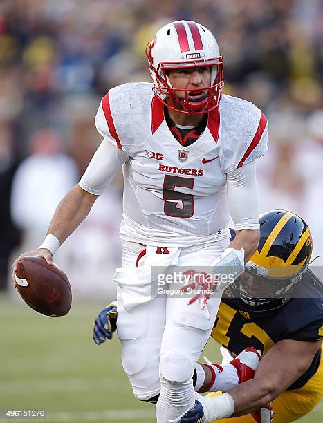 Chris Laviano of the Rutgers Scarlet Knights tries to outrun the sack by Chris Wormley of the Michigan Wolverines during the first quarter on...