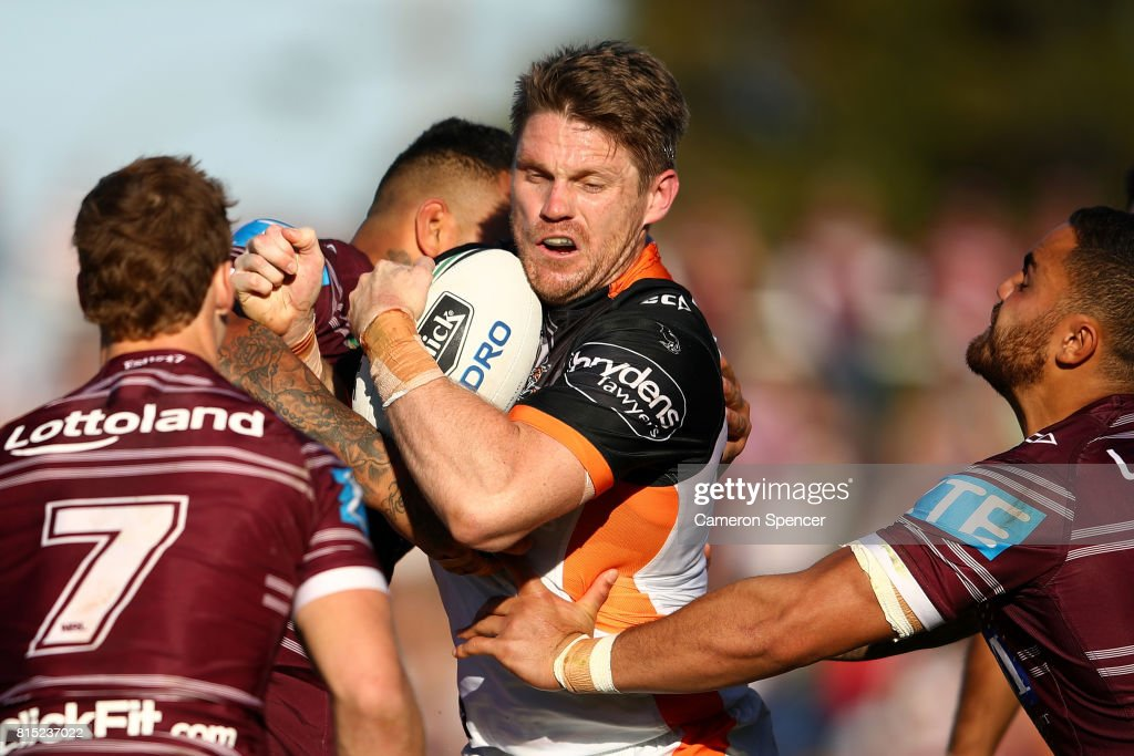 Chris Lawrence of the Tigers is tackled during the round 19 NRL match between the Manly Sea Eagles and the Wests Tigers at Lottoland on July 16, 2017 in Sydney, Australia.