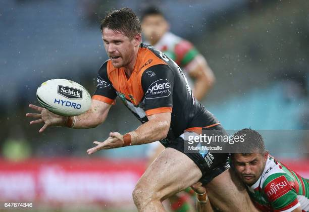 Chris Lawrence of the Tigers passes during the round one NRL match between the South Sydney Rabbitohs and the Wests Tigers at ANZ Stadium on March 3...