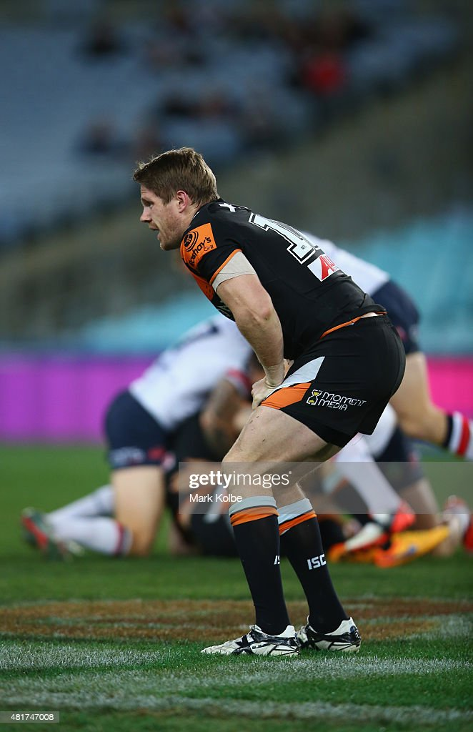 Chris Lawrence of the Wests Tigers grimaces after injuring his leg during the round 20 NRL match between the Wests Tigers and the Sydney Roosters at ANZ Stadium on July 24, 2015 in Sydney, Australia.