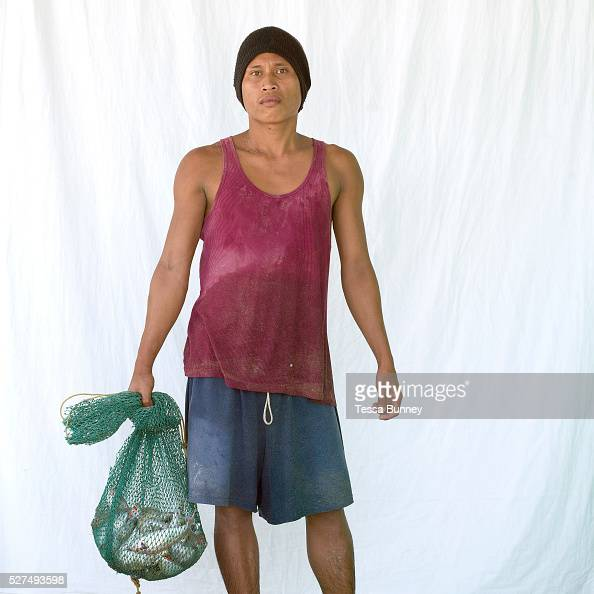 Chris Layaog fisherman Pooc Bantayan Island The Philippines Every morning at 7 am fisherwomen meet fishermen as they return from the sea with their...