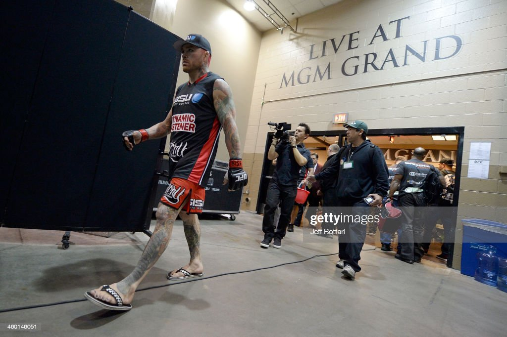 Chris Leben walks out of the locker rooms before his middleweight bout against Uriah Hall during the UFC 168 event at the MGM Grand Garden Arena on December 28, 2013 in Las Vegas, Nevada.