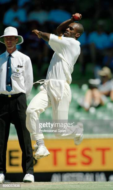 Chris Lewis bowling for England during the 5th Test match between Australia and England at the WACA Perth Australia 3rd February 1995 The umpire is...