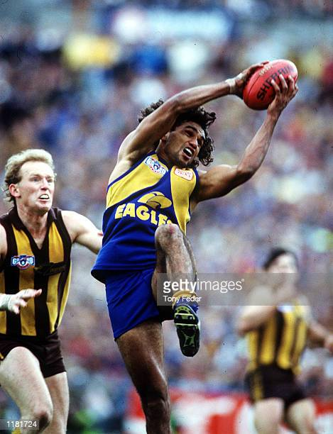 Chris Lewis for the West Coast Eagles takes a strong mark in front of James Morrissey of Hawthorn during the AFL Grand Final game between the West...