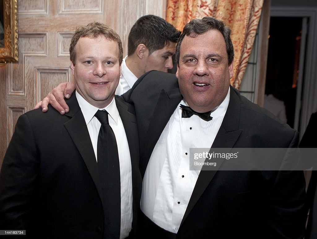 Chris Licht, vice president of programming and executive producer at CBS News Inc., left, and Chris Christie, governor of New Jersey, attend the Bloomberg Vanity Fair White House Correspondents' Association (WHCA) dinner afterparty in Washington, D.C., U.S., on Saturday, April 28, 2012. The 98th annual dinner raises money for WHCA scholarships and honors the recipients of the organization's journalism awards. Photographer: Joshua Roberts/Bloomberg via Getty Images