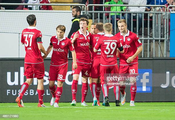Chris Loewe of 1 FC Kaiserslautern celebrates scoring his team's first goal with his teammates during the second Bundesliga match between 1 FC...