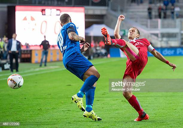 Chris Loewe of 1 FC Kaiserslautern challenges Sueleyman Koc of SC Paderborn during the second Bundesliga match between 1 FC Kaiserslautern and SC...