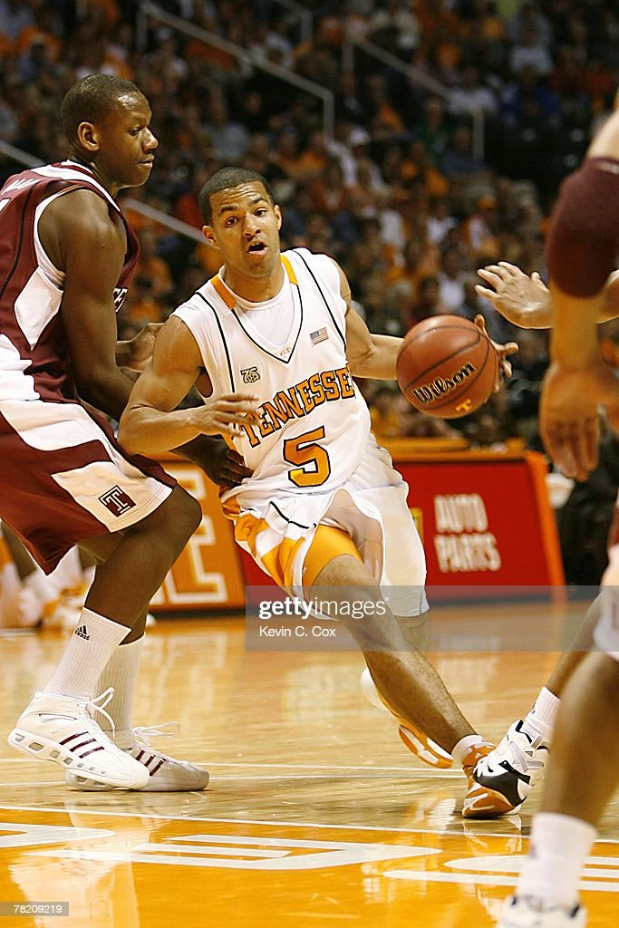 Chris Lofton of the Tennessee Volunteers moves the ball during the college basketball game against the Temple Owls at ThompsonBoling Arena on...
