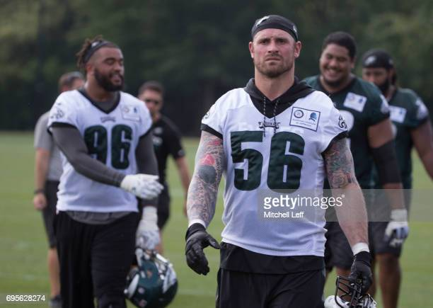 Chris Long and Derek Barnett of the Philadelphia Eagles walk off the field during mandatory minicamp at the NovaCare Complex on June 13 2017 in...
