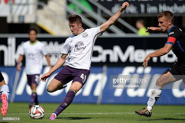 Chris Long of Everton scores his teams opening goal during the pre season friendly match between SC Paderborn and Everton FC at Benteler Arena on...