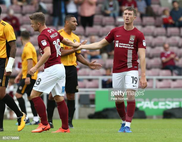 Chris Long of Northampton Town is congratulated by team mate Aaron Phillips after scoring his sides first goal during the PreSeason Friendly match...