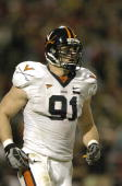 Chris Long of the Virginia Cavaliers walks off the field between plays during the game against the Maryland Terrapins October 20 2007 at Byrd Stadium...