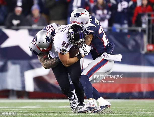 Chris Long Patrick Chung of the New England Patriots tackle Dennis Pitta of the Baltimore Ravens during the second half of the game at Gillette...