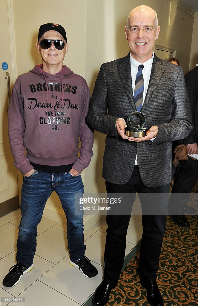 Chris Lowe (L) and <a gi-track='captionPersonalityLinkClicked' href=/galleries/search?phrase=Neil+Tennant&family=editorial&specificpeople=213865 ng-click='$event.stopPropagation()'>Neil Tennant</a> of The Pet Shop Boys, winner of the Outstanding Contribution To Music award, pose in the press room at The Q Awards at The Grosvenor House Hotel on October 21, 2013 in London, England.