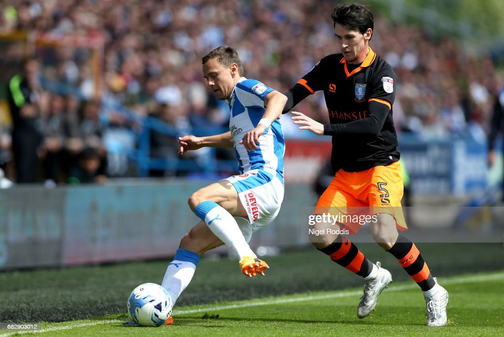 Chris Lowe of Huddersfield Town is put under pressure from Kieran Lee of Sheffield Wednesday during the Sky Bet Championship Play Off Semi Final 1st leg match between Huddersfield Town and Sheffield Wednesday at Galpharm Stadium on May 14, 2017 in Huddersfield, England.
