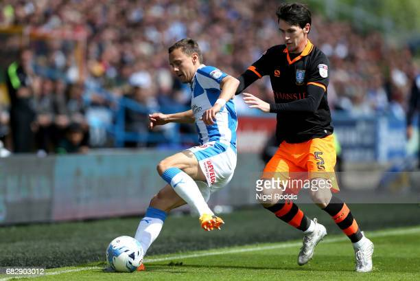 Chris Lowe of Huddersfield Town is put under pressure from Kieran Lee of Sheffield Wednesday during the Sky Bet Championship Play Off Semi Final 1st...