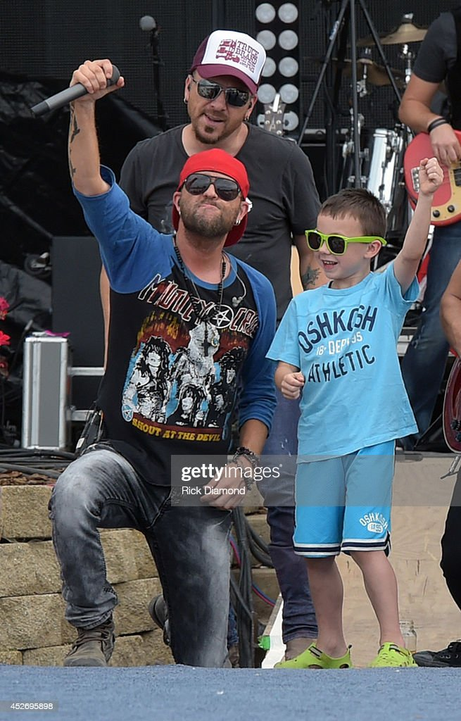 Chris Lucas and Preston Brust (red hat) of Lo Cash Cowboys performs at Country Thunder USA - Day 2 on July 25, 2014 in Twin Lakes, Wisconsin.