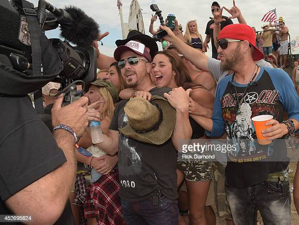Chris Lucas and Preston Brust of Lo Cash Cowboys visit with campers at Country Thunder USA Day 2 on July 25 2014 in Twin Lakes Wisconsin