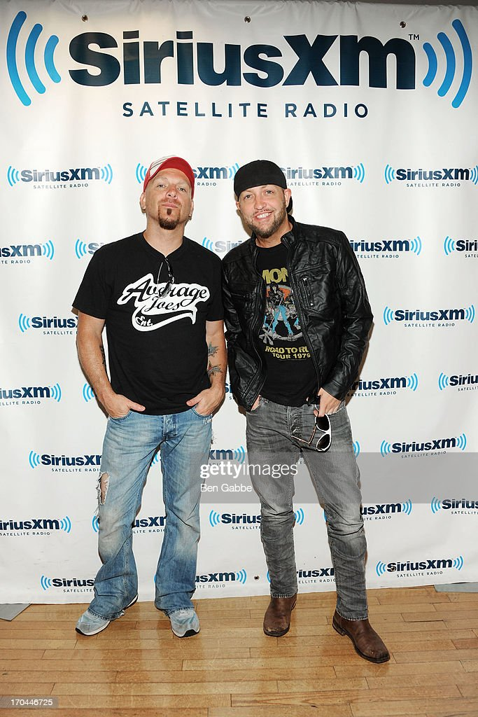 Chris Lucas (L) and Preston Brust of Locash Cowboys visit the SiriusXM Studios on June 13, 2013 in New York City.