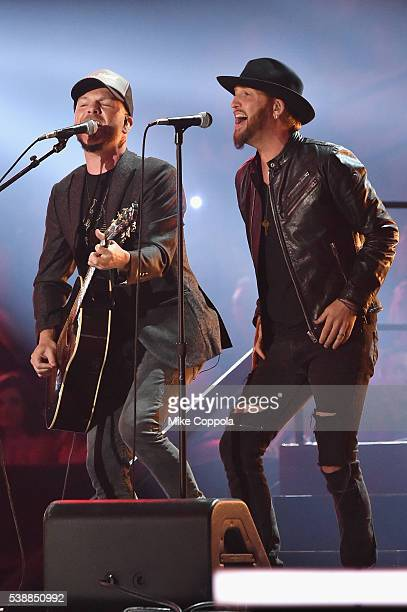 Chris Lucas and Preston Brust of LoCash onstage during the 2016 CMT Music awards at the Bridgestone Arena on June 8 2016 in Nashville Tennessee