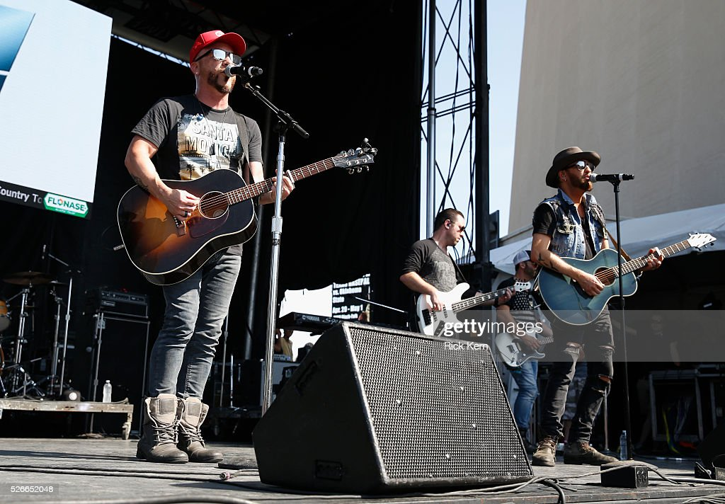 Chris Lucas (L) and Preston Brust (R) of LOCASH perform live during the 2016 Daytime Village at the iHeartCountry Festival at The Frank Erwin Center on April 30, 2016 in Austin, Texas.