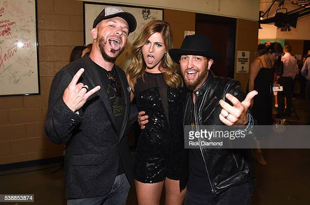 Chris Lucas and Preston Brust of LoCash pose with Cassadee Pope backstage during the 2016 CMT Music awards at the Bridgestone Arena on June 8 2016 in...