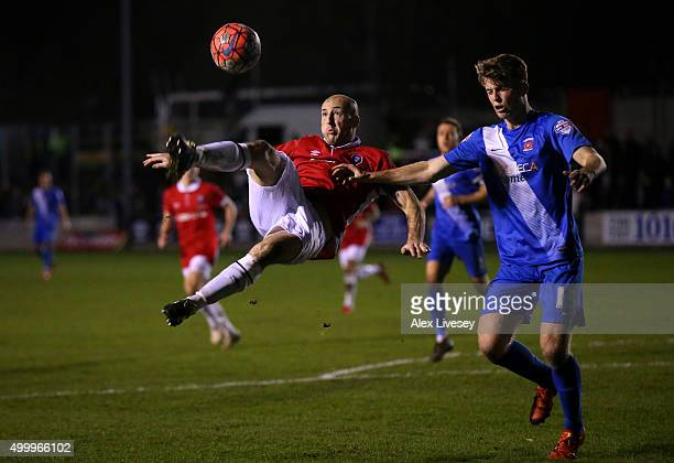 Chris Lynch of Salford City does an overhead kick past Rhys Oates of Hartlepool United during the Emirates FA Cup Second Round match between Salford...