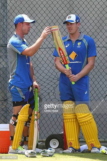 Chris Lynn and James Faulkner talk during an Australian nets session at The Gabba on January 12 2017 in Brisbane Australia