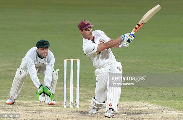 Chris Lynn of Queensland hits the ball over the boundary for a six during day four of the Sheffield Shield match between Queensland and Tasmania at...