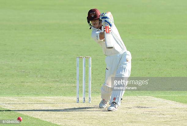 Chris Lynn of Queensland hits the ball to the boundary for a four during day two of the Sheffield Shield match between Queensland and Tasmania at The...