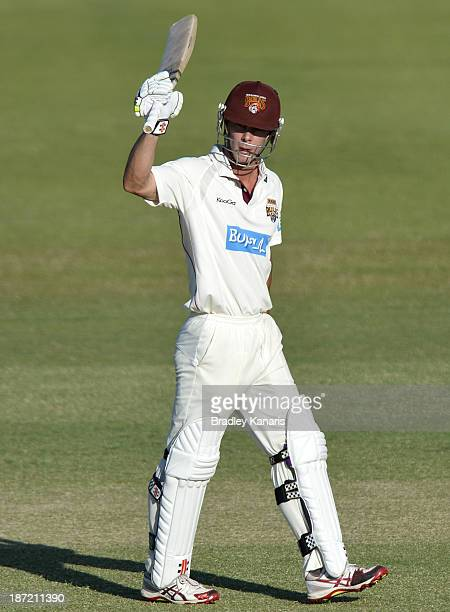 Chris Lynn of the Bulls celebrates scoring a half century during day two of the Sheffield Shield match between the Queensland Bulls and the Tasmania...