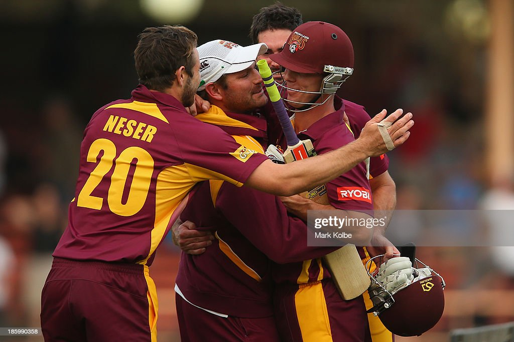 Chris Lynn of the Bulls celebrates victory with his team mates after hitting the winning runs during the Ryobi Cup Final match between the Queensland Bulls and the New South Wales Blues at North Sydney Oval on October 27, 2013 in Sydney, Australia.