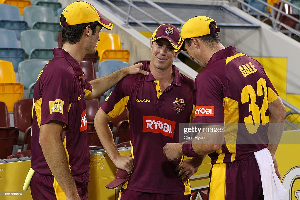 Chris Lynn of the Bulls talks to team mates after being taken to hospital during the Ryobi One Day Cup match between the Queensland Bulls and the New South Wales Blues at The Gabba on November 21, 2012 in Brisbane, Australia.