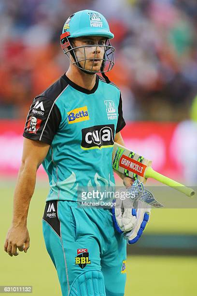 Chris Lynn of the Heat comes off undefeated on 98 after hitting the winning runs during the Big Bash League match between the Perth Scorchers and the...