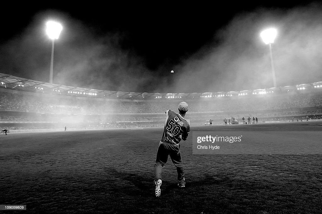Chris Lynn of the Heat fields during the interval of the Big Bash League match between the Brisbane Heat and the Sydney Sixers at The Gabba on January 7, 2013 in Brisbane, Australia.