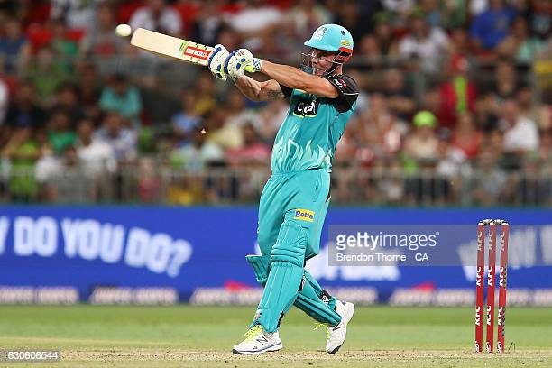 Chris Lynn of the Heat hits for six during the Big Bash League match between the Sydney Thunder and Brisbane Heat at Spotless Stadium on December 28...