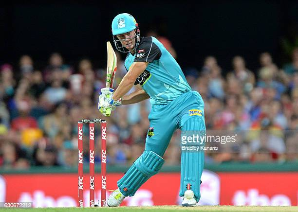 Chris Lynn of the Heat hits the ball over the boundary for a six during the Big Bash League between the Brisbane Heat and Hobart Hurricanes at The...