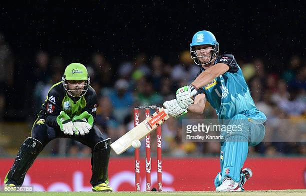 Chris Lynn of the Heat hits the ball to the boundary for a four during the Big Bash League match between the Brisbane Heat and the Sydney Thunder at...