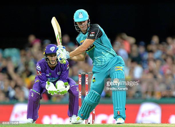 Chris Lynn of the Heat hits the ball to the boundary for a four during the Big Bash League between the Brisbane Heat and Hobart Hurricanes at The...