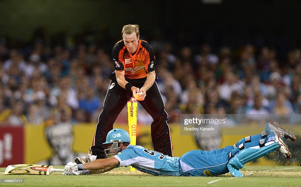 Chris Lynn of the Heat makes his ground during the Big Bash League match between the Brisbane Heat and the Perth Scorchers at The Gabba on December 22, 2013 in Brisbane, Australia.