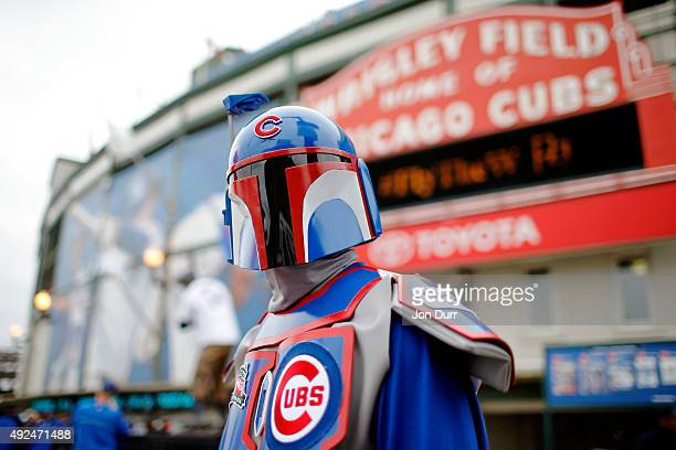 Chris Macht of Gilberts Illinois stands in front of Wrigley Field while dressed as Star Wars character Bobba Fett before Game Four of the National...