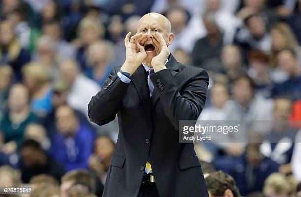 Chris Mack the head coach of the Xavier Musketeers gives instructions to his team during the game against the North Dakota State University at Cintas...