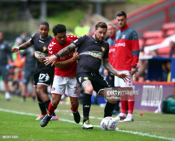 Chris Maguire of Bury holds of Charlton Athletic's Jay Dasilva during Sky Bet League One match between Charlton Athletic against Bury at The Valley...