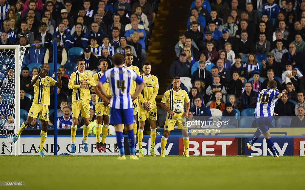 Chris Maguire of Sheffield Wednesday score from a free kick during the Sky Bet Championship match between Sheffield Wednesday and Millwall at Hillsborough Stadium on August 19, 2014 in Sheffield, England.
