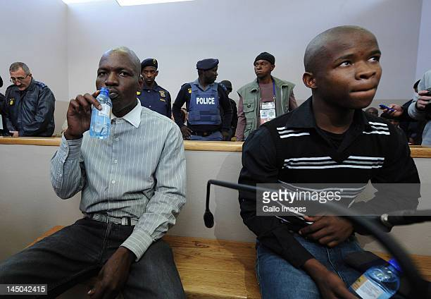 Chris Mahlangu and Patrick Ndlovu appear on trail at the Ventersdorp magistrates court on May 22 2012 in Ventersdorp South Africa The two are accused...