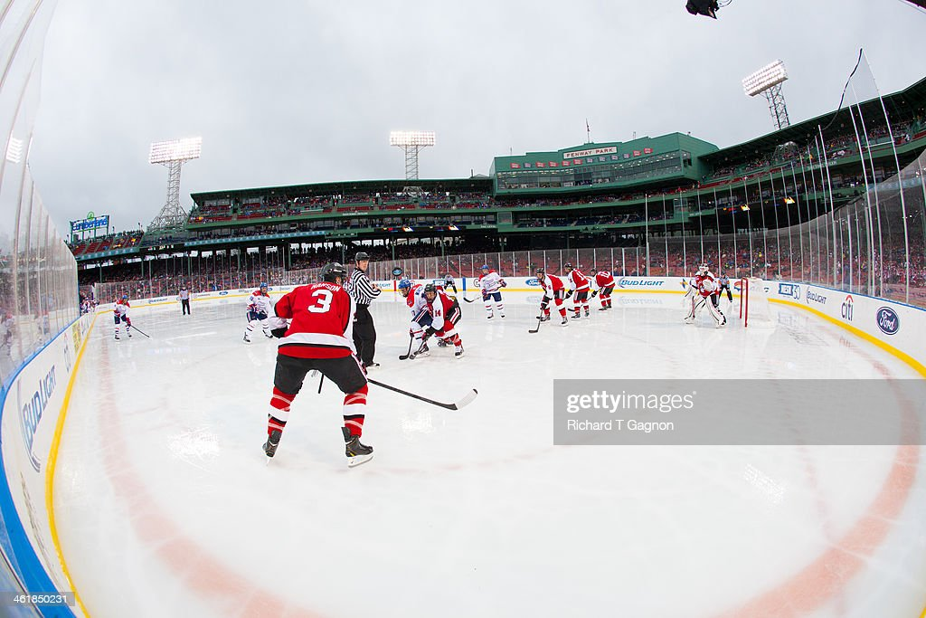 Chris Maniccia #17 of the Massachusetts Lowell River Hawks faces-off against Braden Pimm #14 of the Northeastern University Huskies during NCAA hockey action in the 'Citi Frozen Fenway 2014' at Fenway Park on January 11, 2014 in Boston, Massachusetts.