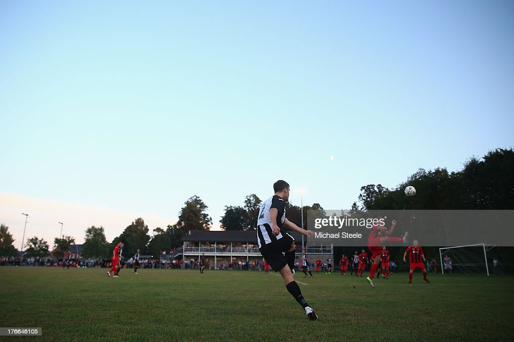 Chris Manning of Alresford Town delivers a cross during the FA Cup Extra Preliminary Round match between Alresford Town and Winchester City at Alrebury Park on August 16, 2013 in New Alresford, England.